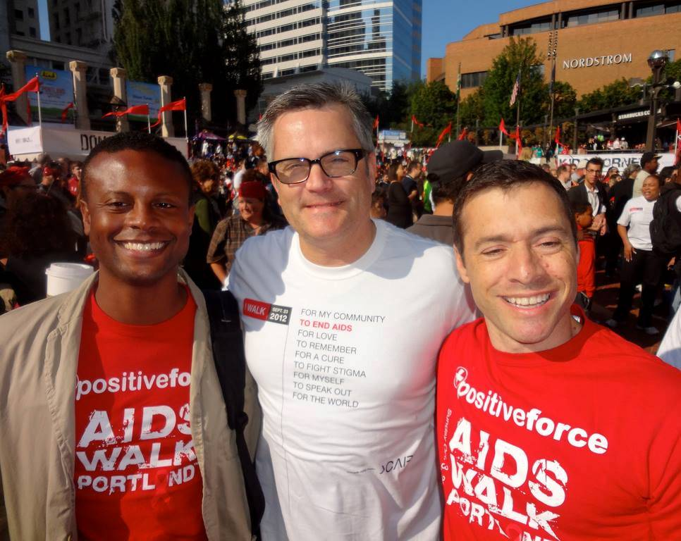 AIDS activist Sean Sasser (left), seen here with former Portland Mayor Sam Adam and Sasser's partner Michael Kaplan at AIDS Walk 2012, died Aug. 7. Photo by Byron Beck.