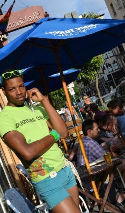 Justin Leon Johnson catches some rays on Scandals' patio. Photo by Jules Garza, PQ Monthly.