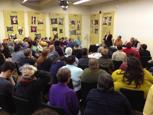 The Q Center was standing-room-only on April 23 when a panel organized by Kathleen Saadat (standing) spoke on racism in the LGBTQ community. Photo courtesy of Q Center.