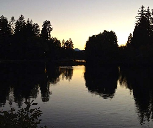 Mirror Pond--before the leak--at sunset. Photo by Corbin Gentzler.