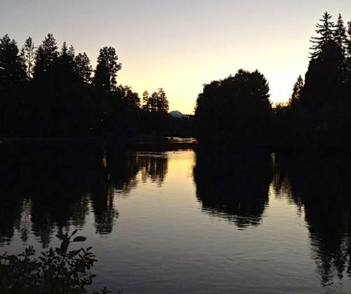 Mirror Pond--before the leak--at sunset. Photo by Corbin Gentzler.